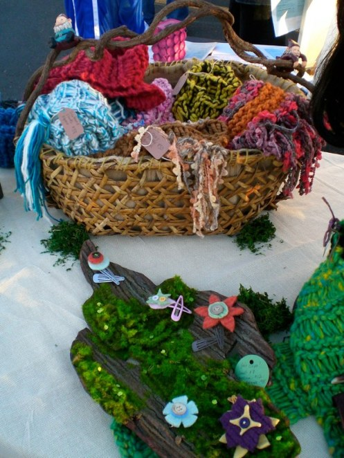 The kittyknitter basket with felted hair clips on mossy bark